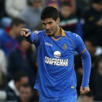 Getafe's Lisandro Lopez celebrates his goal during a Spanish La Liga soccer match between FC Barcelona and Getafe at the Coliseum Alfonso Perez stadium in Madrid, Spain, Sunday, Dec. 22, 2013. (AP Photo/Andres Kudacki)